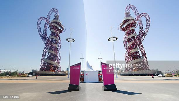 The ArcelorMittal Orbit sculpture by British artist Anish Kapoor is reflected in a polished art installation within the Olympic Park in London on...