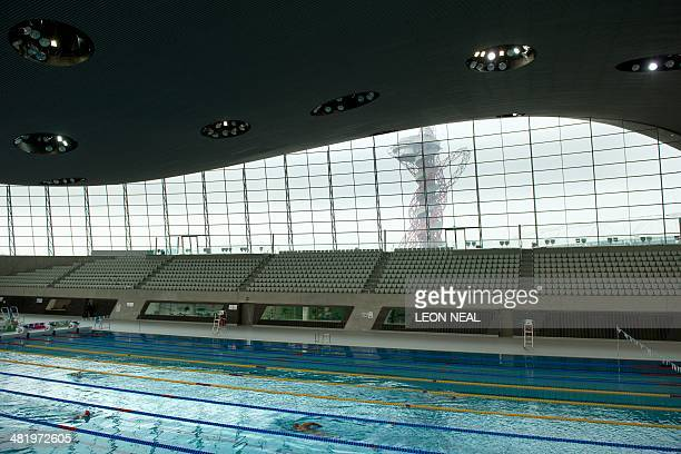The ArcelorMittal Orbit tower in the Queen Elizabeth Olympic Park east London is seen through the window of the Aquatics Centre on April 2 2014 The...