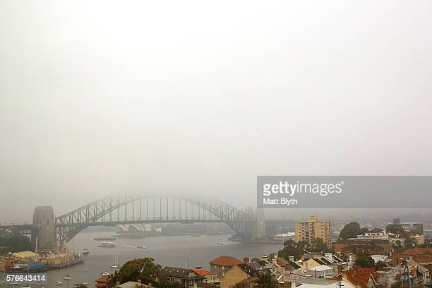 The arch of the Sydney Harbour Bridge shrouded in fog on July 17 2016 in Sydney Australia Early morning fog covered the Sydney Harbour Bridge and...