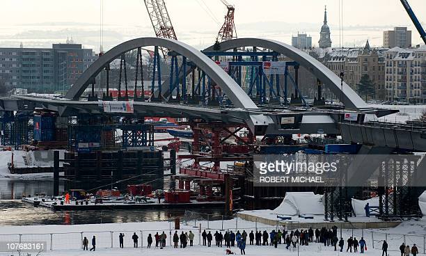 The arch of the Waldschloesschen Bridge is put in by floating pontoons on the river Elbe at the construction site in Dresden eastern Germany on...