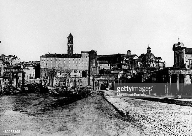 The Arch of Titus the church of Saints Luca and Martina with the dome and the church of San Lorenzo in Miranda standing along the Via Sacra In the...