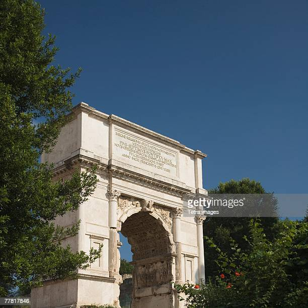 The Arch of Titus under blue sky, Roman Forum, Italy