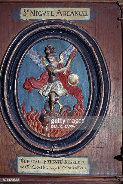 The Archangel Michael decoration on one of the stalls in the Monastery of St Francis in Estepa Andalusia Spain
