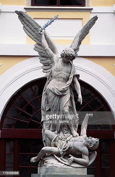The Archangel Michael subduing Satan statue in the Archbishop's Palace Kromeriz Czech Republic