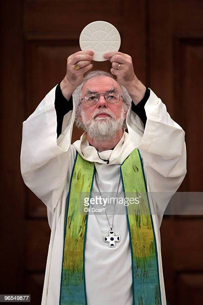 The Archbishop of Canterbury Dr Rowan Williams delivers Holy Communion at the beginning of the third day of the General Synod on February 10 2010 in...