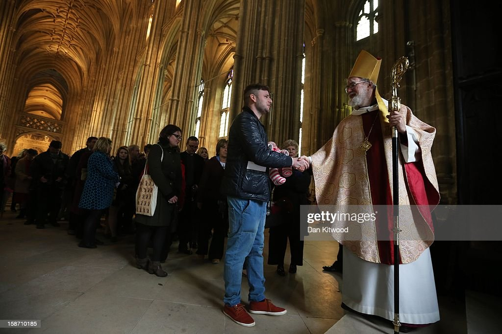 The Archbishop of Canterbury, Dr Rowan Williams greets members of the congregation after giving his final Christmas Day address at Canterbury Cathedral on December 25, 2012 in Canterbury, England. Dr Williams gave his last Christmas sermon as Archbishop of Canterbury today, before being succeeded by Justin Welby, the Bishop of Durham.