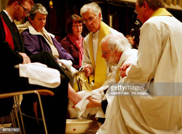 The Archbishop of Canterbury Dr Rowan Williams performs the Maundy Thursday feet washing ceremony accompanied by the Very Reverend Robert Willis,...