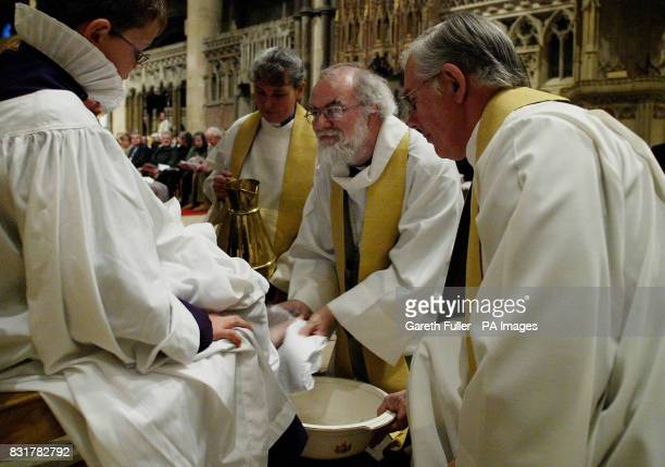 The Archbishop of Canterbury, Dr. Rowan Williams performs the Maundy Thursday feet washing ceremony at Canterbury Cathedral in Kent.