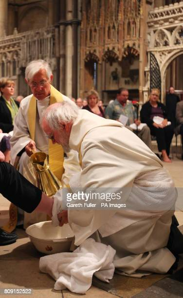 The Archbishop of Canterbury Dr. Rowan Williams performs the Washing of The Feet ceremony during the Maundy Thursday service at Canterbury Cathedral...