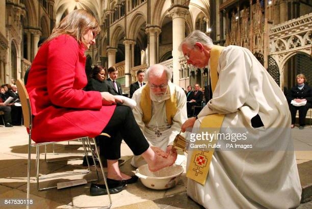 The Archbishop of Canterbury Dr. Rowan Williams performs the Washing of The Feet ceremony accompanied by the Dean of Canterbury Cathedral, Rev Robert...