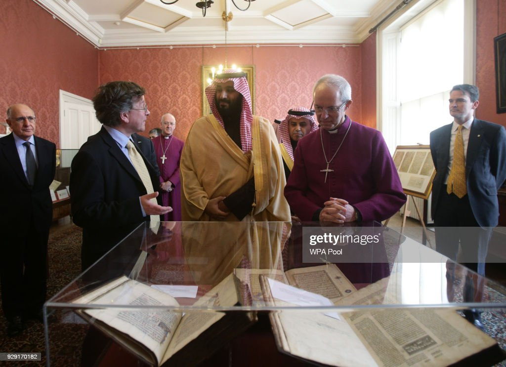 The Archbishop of Canterbury Justin Welby (right) accompanies the Crown Prince of Saudi Arabia, HRH Mohammed bin Salman (centre), as they view a selection of early texts from the Christian, Muslim and Jewish faiths from the Lambeth Palace library collection, at a private meeting at Lambeth Palace hosted by the Archbishop of Canterbury Justin Welby on March 8, 2018 in London, United Kingdom.