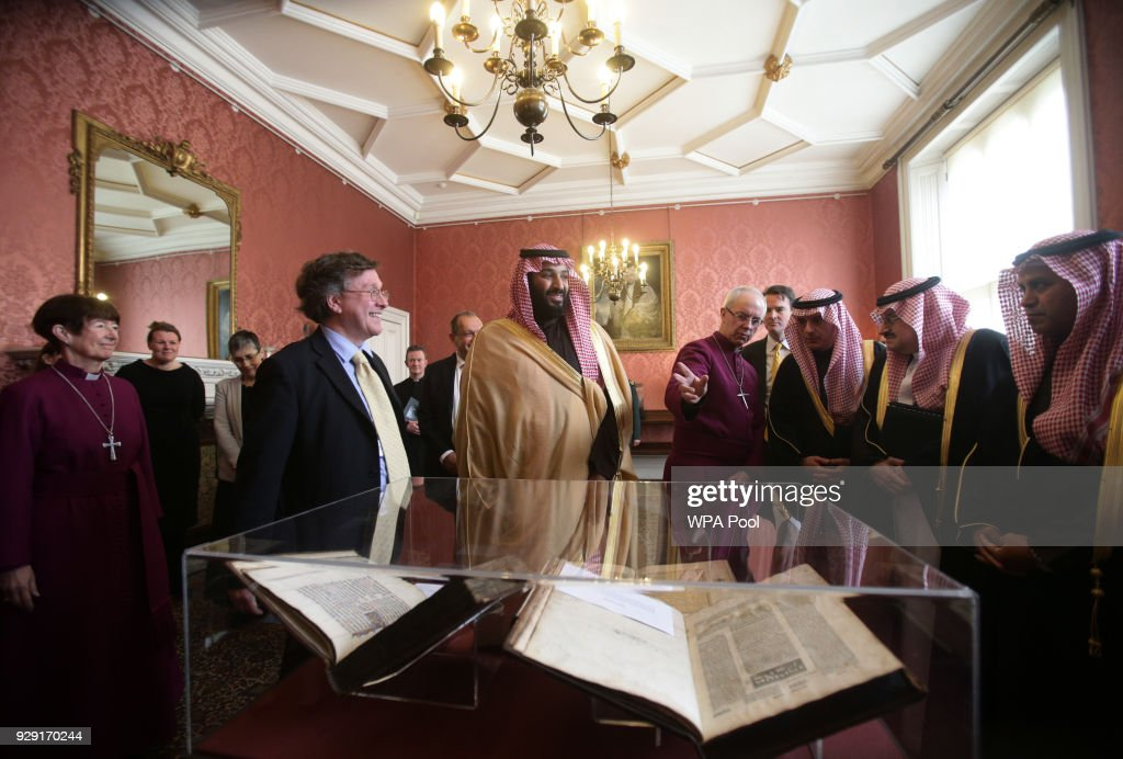 The Archbishop of Canterbury Justin Welby (centre right) accompanies the Crown Prince of Saudi Arabia, HRH Mohammed bin Salman (centre), as they view a selection of early texts from the Christian, Muslim and Jewish faiths from the Lambeth Palace library collection, at a private meeting at Lambeth Palace hosted by the Archbishop of Canterbury Justin Welby on March 8, 2018 in London, United Kingdom.