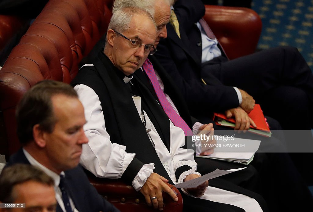 The Archbishop of Canterbury Justin Welby listens during the first sitting of Norman Fowler, the new Lord Speaker, at a session of the House of Lords at the Houses of Parliament in London on September 5, 2016. The House of Lords is the upper house of the UK parliament. / AFP / POOL / Kirsty Wigglesworth
