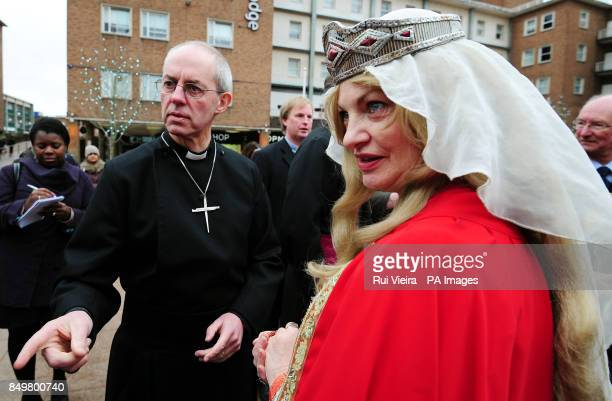 The Archbishop of Canterbury Justin Welby meets Pru Porretta dressed as as Lady Godiva during a visit to the ruins of the old Cathedral in Coventry