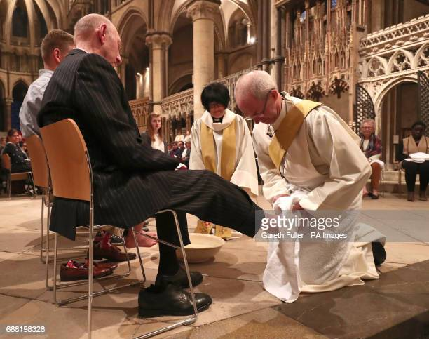 The Archbishop of Canterbury Justin Welby performs the Washing of The Feet ceremony during the Maundy Thursday service at Canterbury Cathedral in...