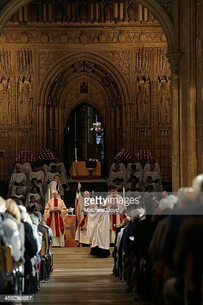 The Archbishop of Canterbury Justin Welby prays during Christmas Day Mass at Cantebury Cathedral on December 25 2013 in Canterbury England Today...