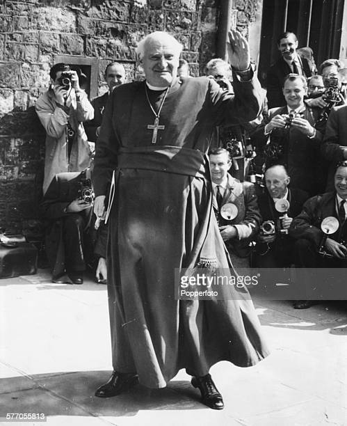 The Archbishop of Canterbury Michael Ramsey waves to the crowd as he arrives for a wedding rehearsal of Princess Alexandra and Angus Ogilvy at...