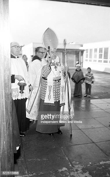 The Archbishop of Dublin Most Rev Dr John Charles Mc Quaid blessing one of the classrooms at the opening of the St Pius X Primary school Fortfield...