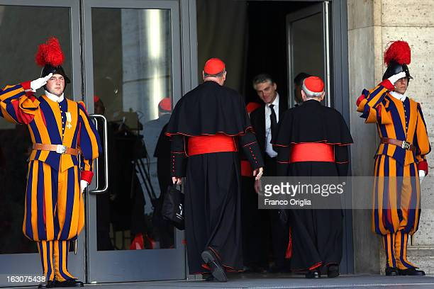 The Archbishop of New York, cardinal Timothy Dolan and the former Archbishop of Philadelphia, Cardinal Justin Rigali , arrive at the Paul VI hall for...