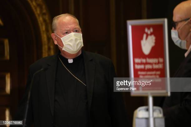 The Archbishop of New York, Cardinal Timothy Dolan, attends a press conference at Our Saviour Parish in Manhattan regarding the reopening of churches...