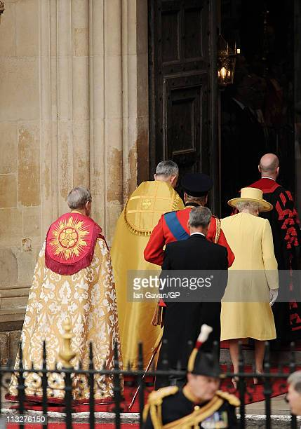 The Archbishop of Wales The Most Reverend Doctor Barry Morgan and The Right Reverend Dr John Hall walk in with Queen Elizabeth II and Prince Philip...