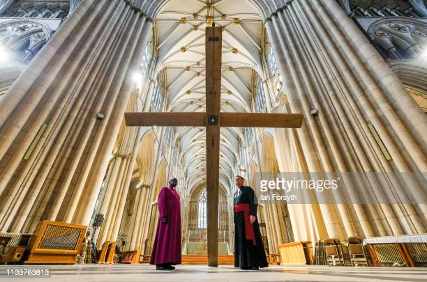 The Archbishop of York Dr John Sentamu and The Dean of York the Right Reverend Dr Jonathan Frost attend a media call as a wooden cross is suspended...