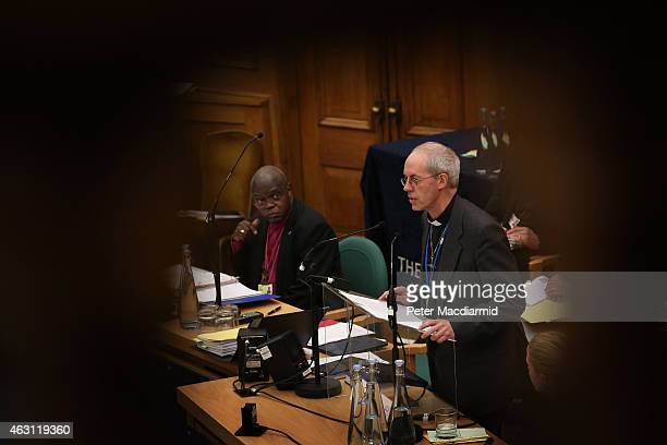 The Archbishop of York, John Sentamu looks on as The Archbishop of Canterbury, Justin Welby addresses the General Synod at Church House on February...