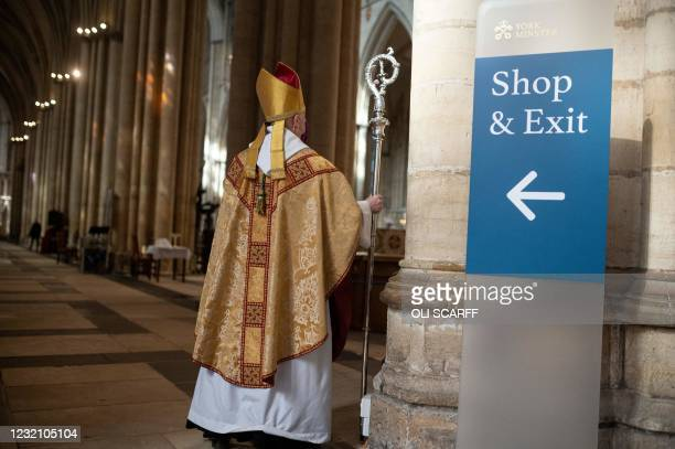 The Archbishop of York, The Most Reverend Stephen Cottrell, wearing a protective face covering to combat the spread of the coronavirus, leaves after...
