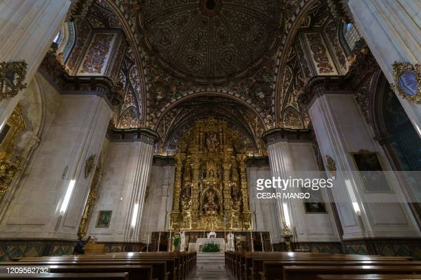The archibishop of Burgos Fidel Herraez sais the Holy Thursday mass at the empty Cathedral in Burgos on April 9 during a national lockdown to prevent...