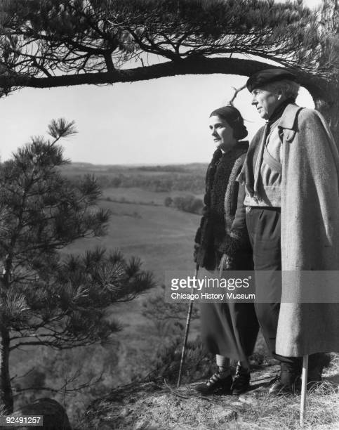 The architect Frank Lloyd Wright and his wife Olgivanna on the Taliesin East grounds in Spring Green WI December 1937