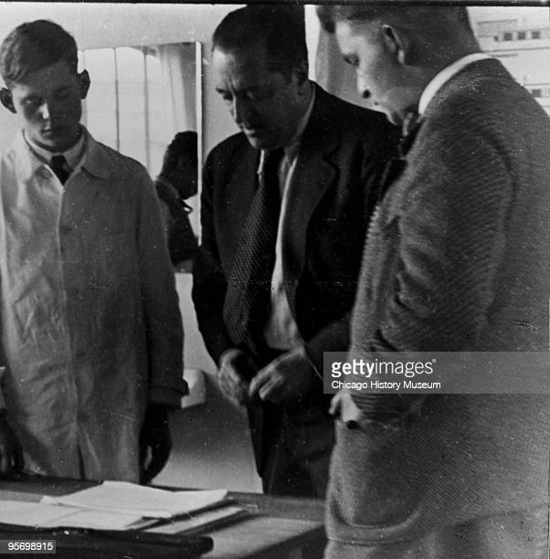 The architect Mies van der Rohe with two unidentified men, ca.1960s.