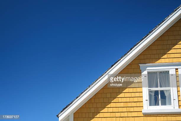 the architectural detail of a roofline on a home - roof stock photos and pictures
