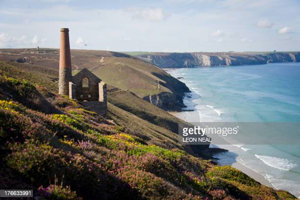 The architectural remains of historical tin mines sit on the cliffs overlooking Porthtowan Bay near Truro in Cornwall, southwestern England on August...