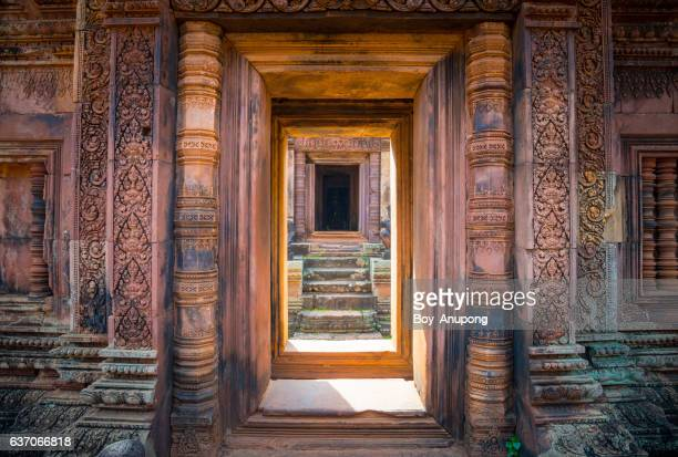 the architecture of banteay srei temple the beautiful pink sandstone of siem reap, cambodia. - khmer art stock photos and pictures