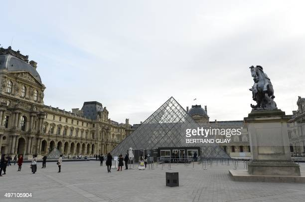 The area around the Louvre Pyramid at the Louvre museum in Paris stands largely deserted on November in Paris on November 14 following a series of...