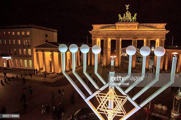 The area is illuminated after the lighting of the Hanukkah menorah at a public Menorah ceremony near the Brandenburg Gate on December 6 2015 in...