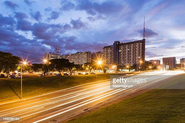 the area near the brasilia tv tower at twilight - distrito federal brasilia stock pictures, royalty-free photos & images