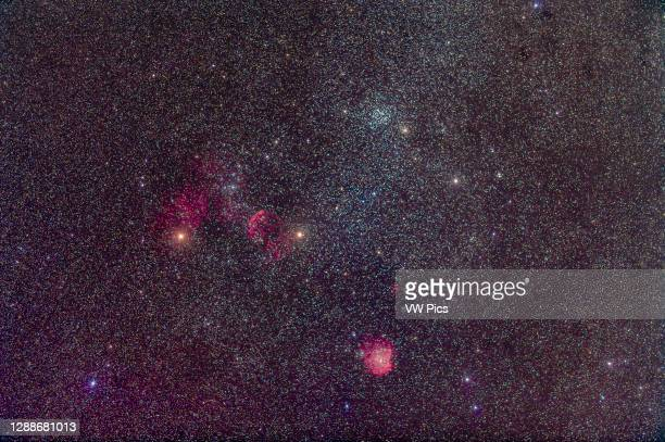 The area of sky around the star cluster Messier 35, at top in Gemini, with the supernova remnant IC 443 below, and the Monkeyhead Nebula, IC 2174, in...