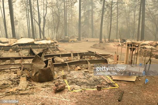 The area where a body was found is marked by tape in Paradise California on November 14 2018 Thousands of firefighters battled blazes in northern and...