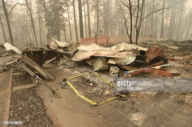 The area where a body was found is marked by tape in Paradise California on November 14 2018 Firefighters backed by air tankers and helicopters...