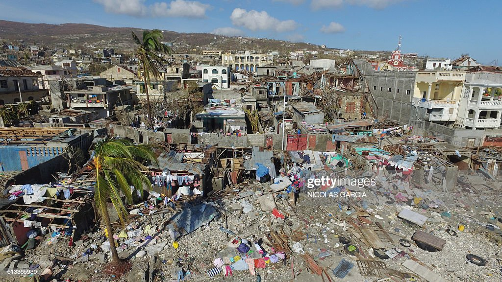 The areas of Jeremie, Haiti, destroyed by Hurricane Matthew are seen from the air on October 8, 2016. The full scale of the devastation in hurricane-hit rural Haiti became clear as the death toll surged over 400, three days after Hurricane Matthew leveled huge swaths of the country's south. / AFP / Nicolas GARCIA