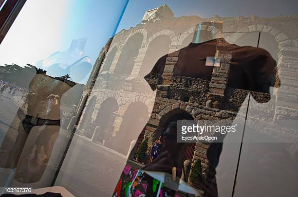 The Arena di Verona is reflected in the shop window of a lingerie shop at Piazza Bra on July 14 2010 in Verona Italy The famous Arena di Verona is...