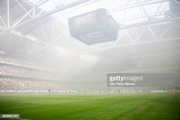 The arena filled with smoke during the Allsvenskan match between AIK and Djurgardens IF at Friends arena on August 27 2017 in Solna Sweden