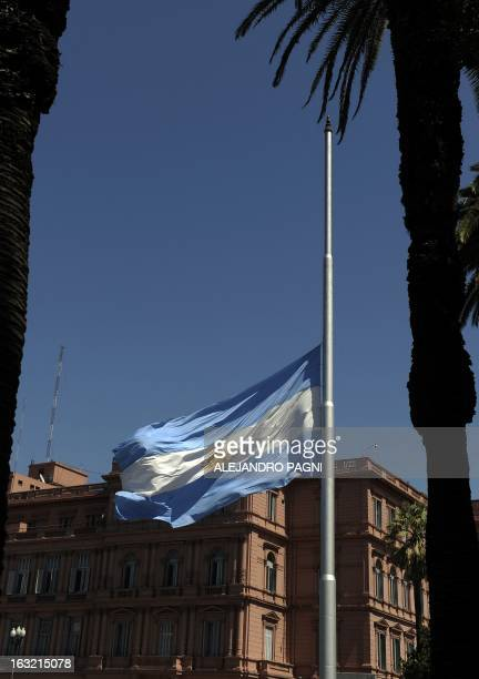 The Argentime flag is at half mast for the demise of Venezuelan President Hugo Chavez near the Casa Rosada government house in Buenos Aires on March...