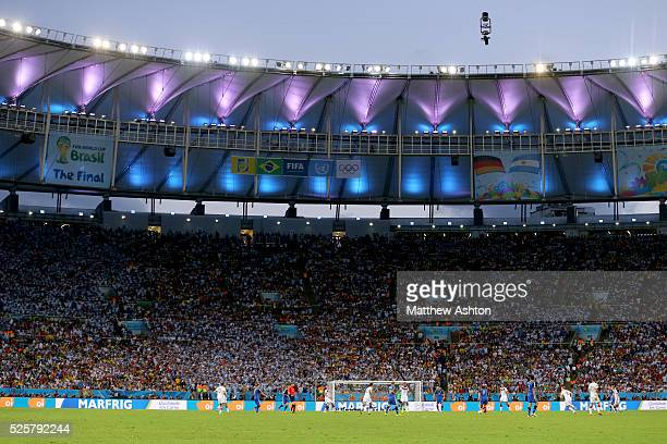 The Argentina and Germany flags alongside FIFA World Cup branding in the Maracana stadium