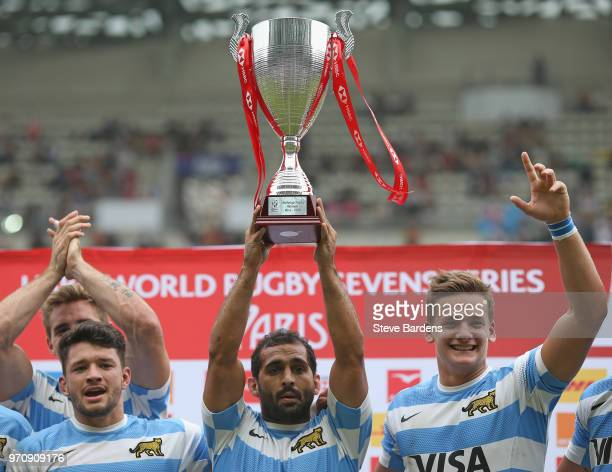 The Argentina players celebrate with the Trophy after their victory over Wales after the Trophy Final between Argentina and Wales during the HSBC...