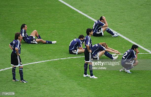 The Argentina players show their dejection following their team's defeat in a penalty shootout at the end of the FIFA World Cup Germany 2006...