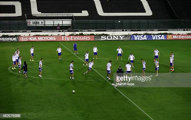 The Argentina players warm up during the Argentina training session ahead of the 2014 FIFA World Cup Final at Estadio Sao Januario on July 12 2014 in...