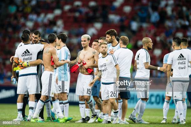 The Argentina squad celebrate after winning the match during the International Test match between Argentina and Singapore at National Stadium on June...