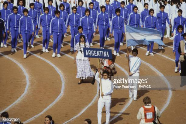 The Argentina squad walking behind their flag during the opening ceremony